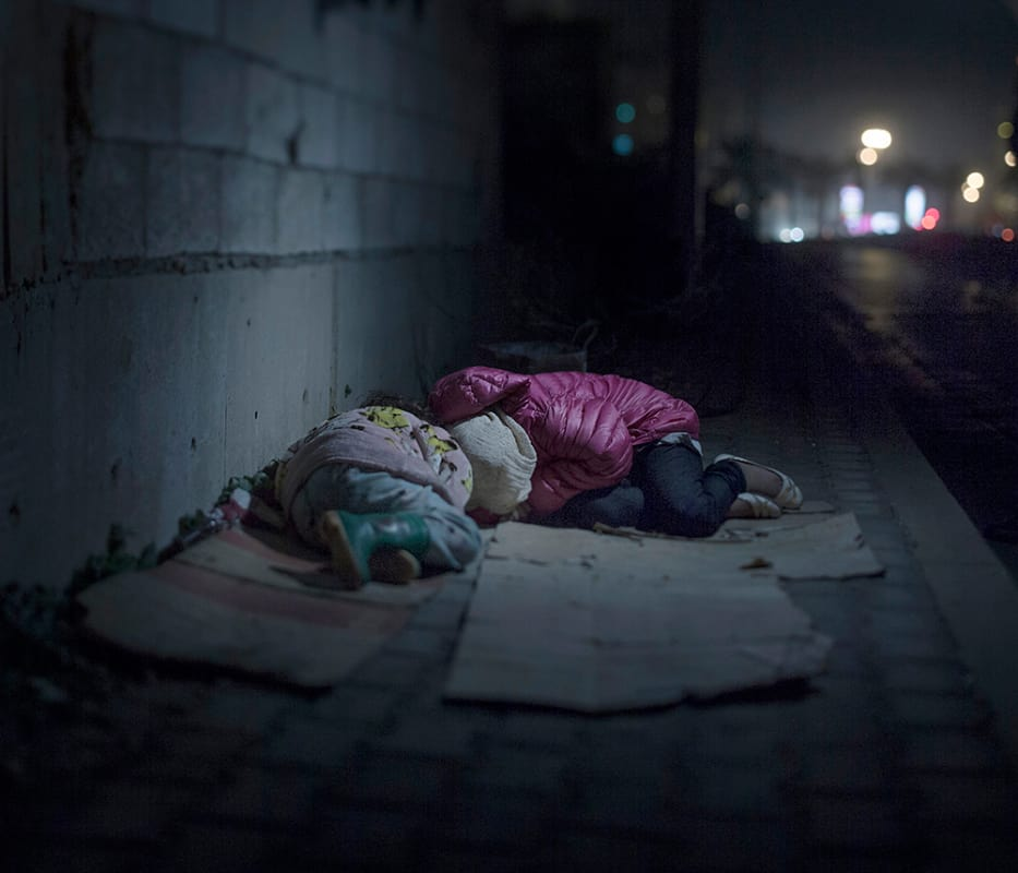 """One child misses her bed. Another misses her dark-eyed doll. A third dreams of the old days, when her pillow didn't feel like an enemy. Two million children have fled Syria. Leaving behind their friends, their homes, their beds. A dozen of these children have invited us to come and see where they now sleep, now that everything they once had is gone. Ralia, 7 and Rahaf, 13 BEIRUT (Lebanon). Ralia, 7, and Rahaf, 13, live on the streets of Beirut. They are from Damascus, where a grenade killed their mother and brother. Along with their father, they have been sleeping rough for a year. They huddle close together on their cardboard boxes. Rahaf says she is scared of """"bad boys,"""" at which Ralia starts crying."""
